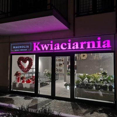 Świecąca reklama kwiaciarni